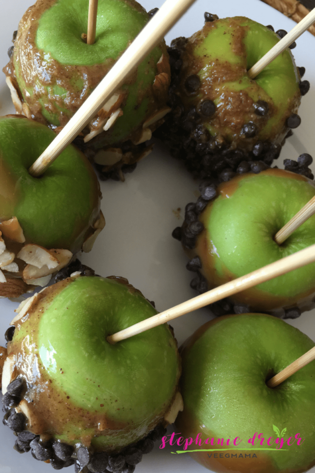 These #vegan dairy-freed caramel apples are a healthier alternative to the traditional version - and super easy with just 2 ingredients for the caramel.