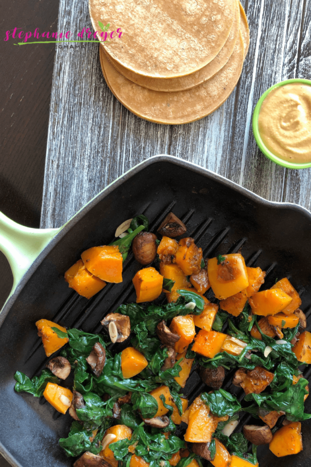 These Butternut Squash Fajitas are a mouthful of flavor. With roasted mushrooms, garlic and sauteed spinach and topped with a Butternut Squash Crema, they are a taste of Fall!