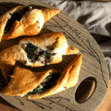 These Stuffed Crescent Rolls are my doughy take on a stuffed mushroom! Stuffed with a garlicky mushroom and spinach filling, these rolls are an elegant addition to the holiday table.
