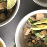 This Tofu Salsa Verde is a Mexican inspired green rice bowl featuring tomatillo salsa, black beans and extra firm tofu. Topped with avocado, cilantro and lime wedges, this is delicious comfort food served straight from the slow cooker or instant pot.